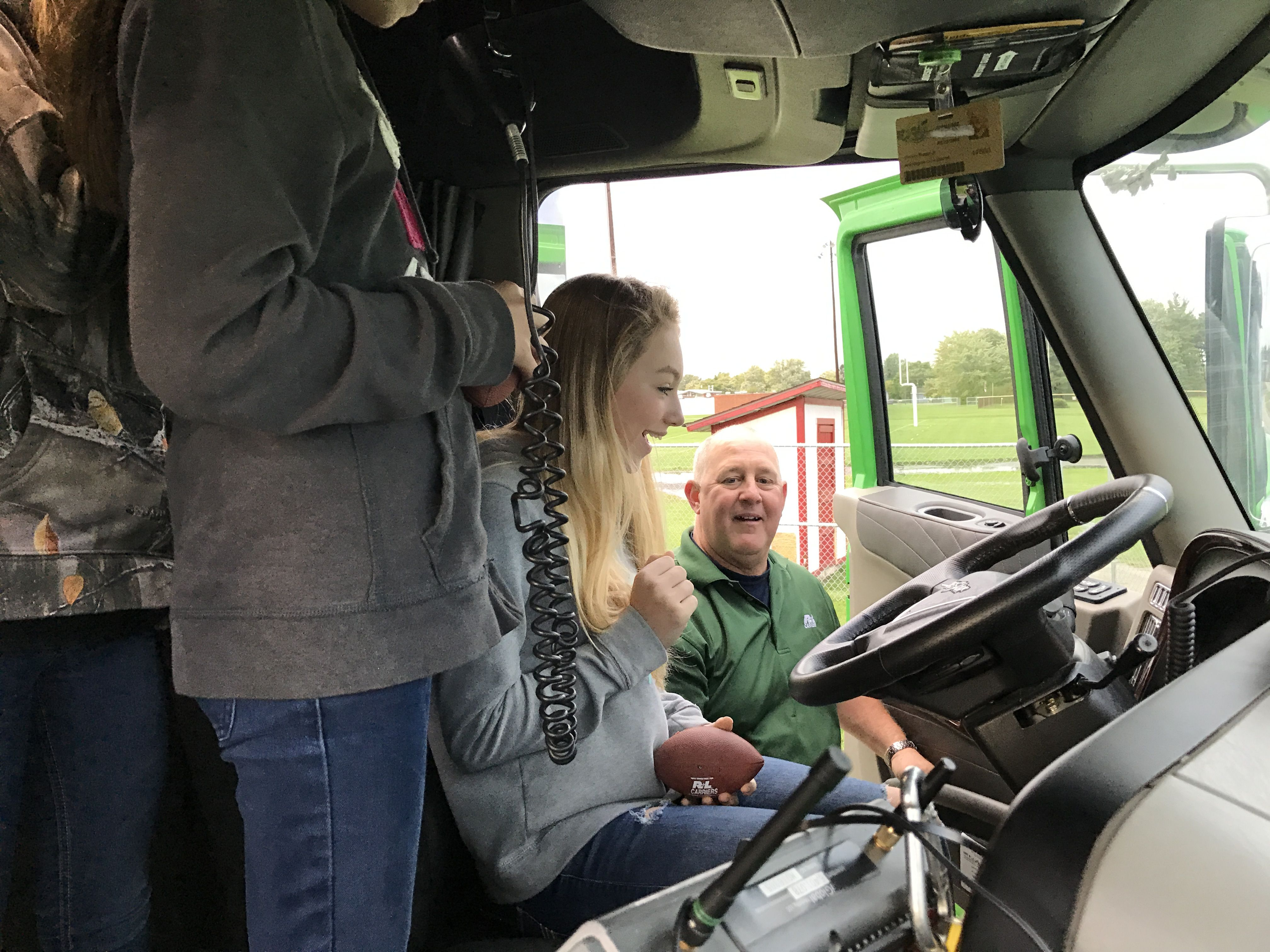 Cardinal High School student takes the wheel of the hauler.
