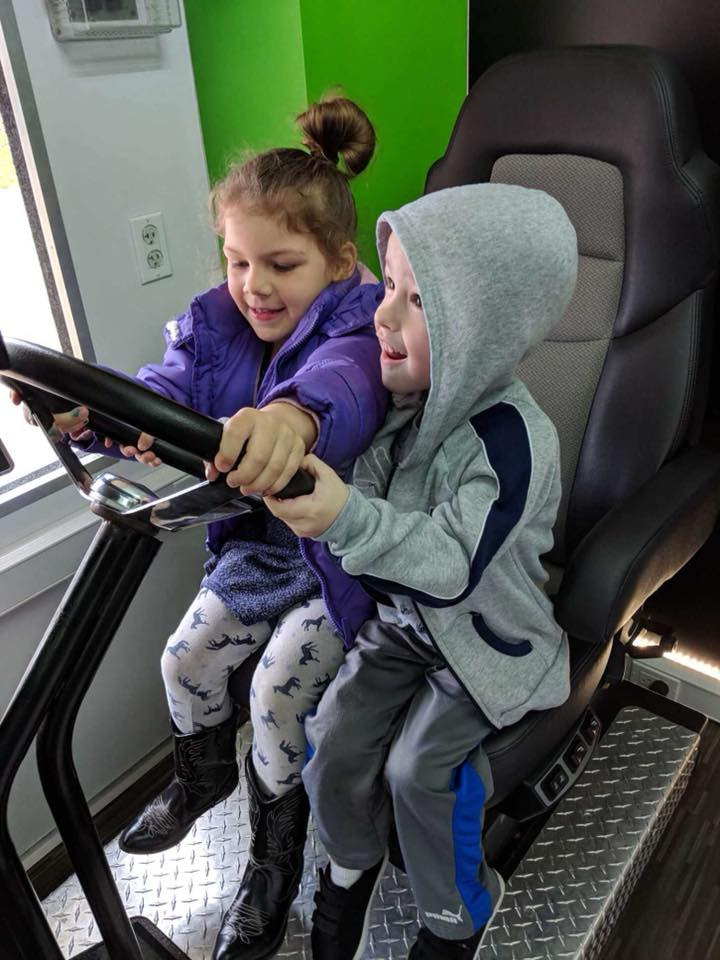 Educating East End students with the Bose Ride simulator.